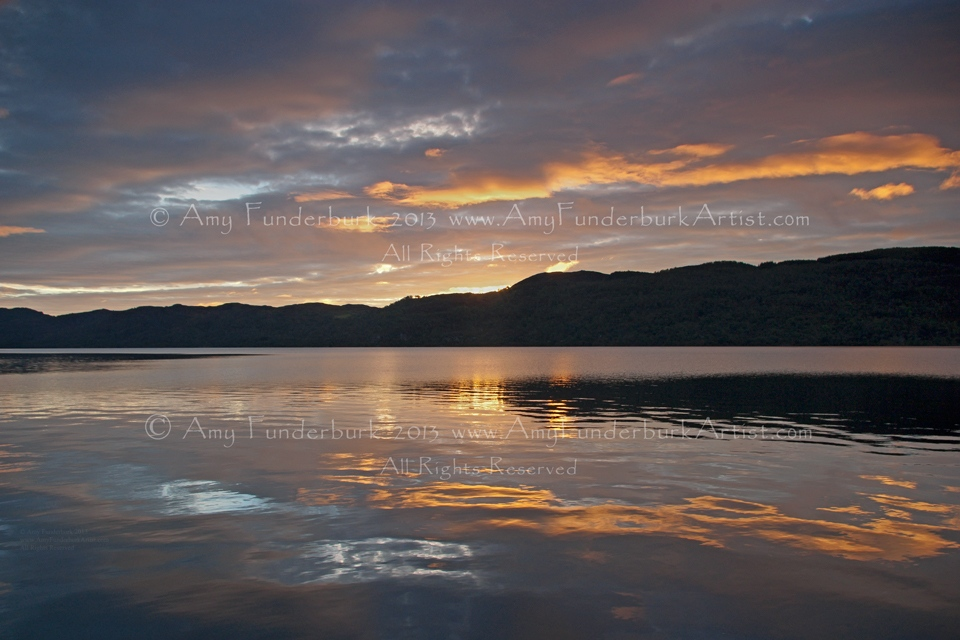Loch Ness Sunrise with Light Nessie-Shaped Reflection